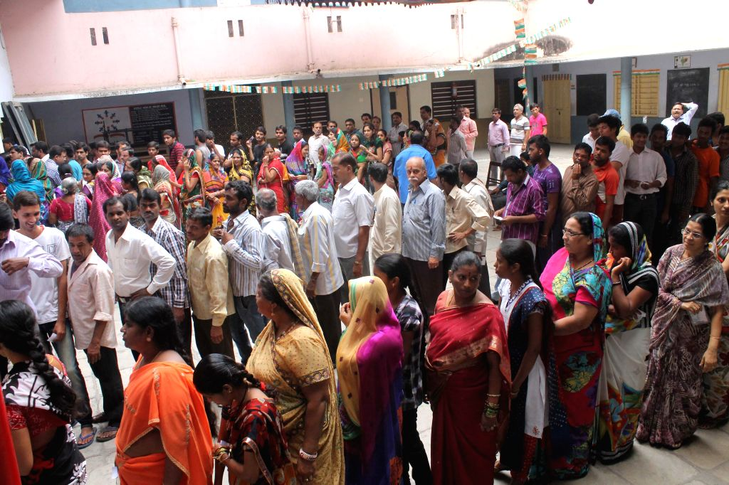 People queue-up to cast their votes at a polling booth during the seventh phase of 2014 Lok Sabha Polls in Hyderabad on April 30, 2014.