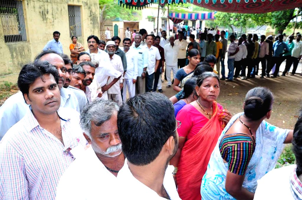 People queue-up to cast their votes at a polling booth during the eighth phase of 2014 Lok Sabha Polls in Kurnool district of Andhra Pradesh on May 7, 2014.