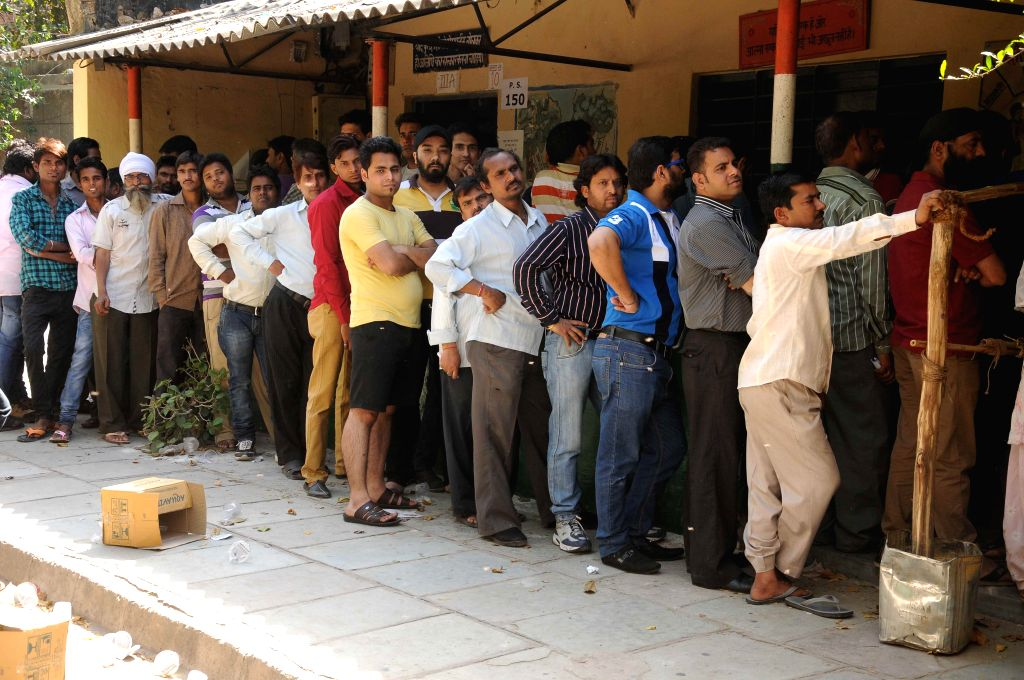 People queue-up to cast their votes at a polling booth during the third phase of 2014 Lok Sabha Polls in New Delhi on April 10, 2014. Elections are being held in 91 parliamentary constituencies of India. (Photo: IANS)