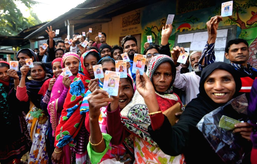 People queue up to cast their votes during Assam Panchayat polls in Guwahati on Dec 5, 2018.