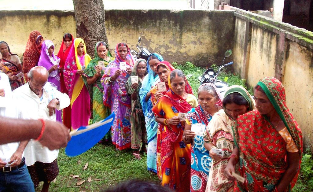 People queue-up to cast their votes during by-elections  in Saran Lok Sabha constituency of Bihar on Aug 21, 2014.