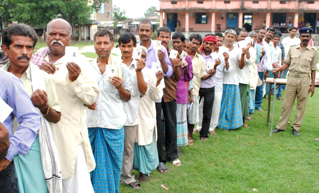 People queue-up to cast their votes during by-elections  in Chapra Lok Sabha constituency of Bihar on Aug 21, 2014.