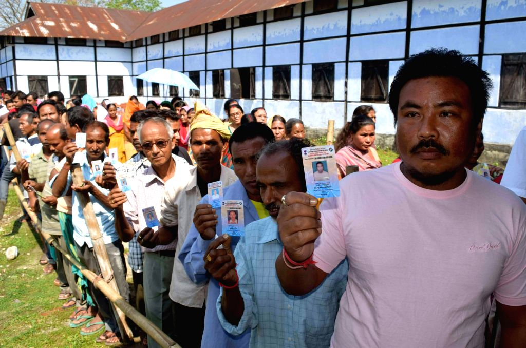 People queue-up to cast their votes during the BTC polls in Kokrajhar, Assam on April 8, 2015.