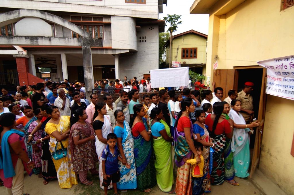People queue-up to cast their votes during the second phase of Assam Legislative Assembly polls in Nagaon, on April 11, 2016.
