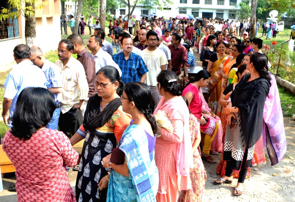 People queue-up to cast their votes during the second phase of Assam Legislative Assembly polls in Guwahati, on April 11, 2016.