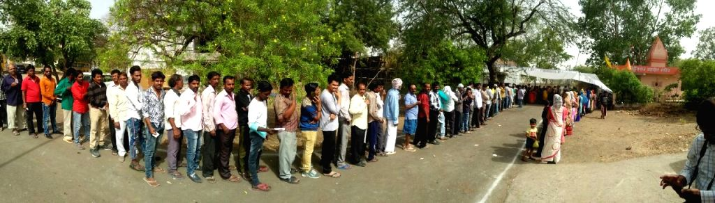 People queue up to cast their votes during the sixth phase of 2019 Lok Sabha elections, in Bhopal on May 12, 2019.