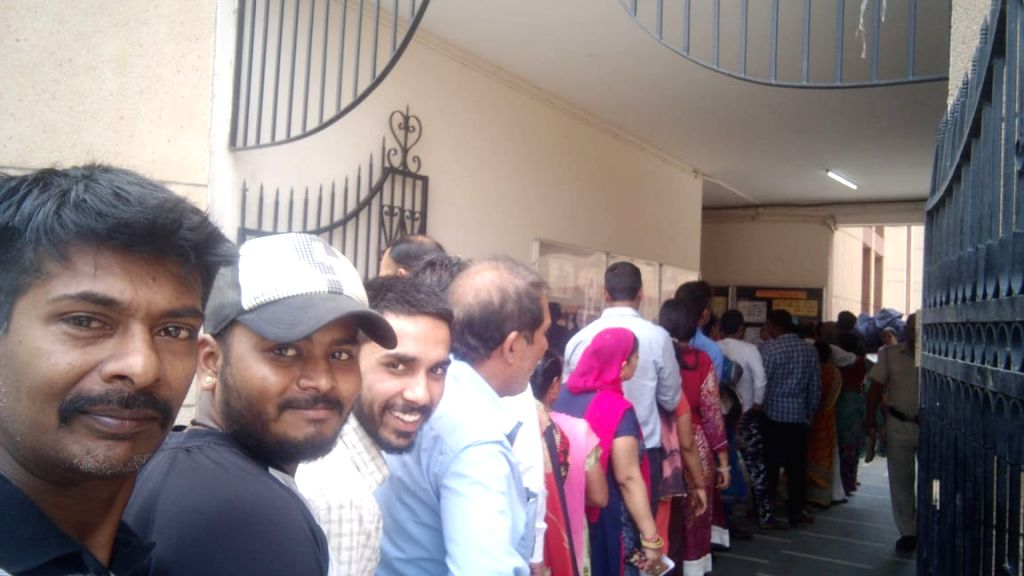 People queue up to cast their votes during the sixth phase of 2019 Lok Sabha elections, in Faridabad, Haryana on May 12, 2019.