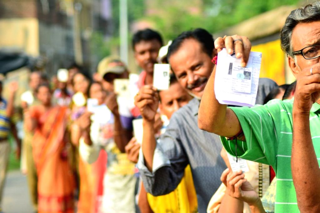 People queue up to cast their votes during the sixth phase of 2019 Lok Sabha elections, in Bankura, West Bengal on May 12, 2019.