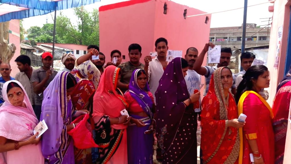 People queue up to cast their votes during the sixth phase of 2019 Lok Sabha elections, in Chhapra, Bihar on May 12, 2019.