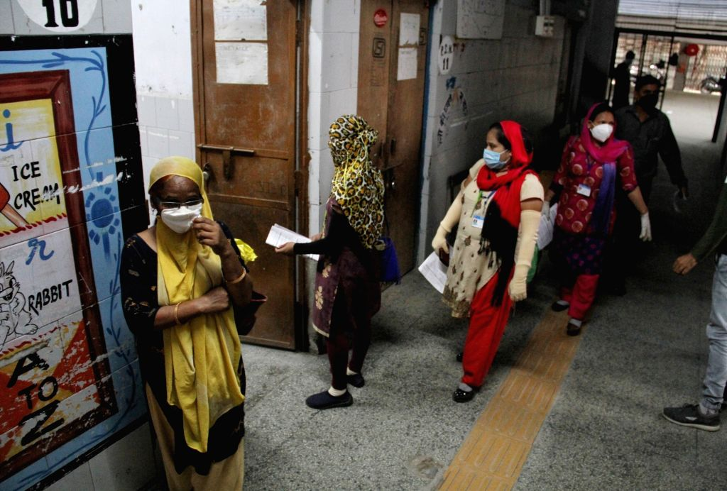 People queue up to give blood and swab samples  at a Covid Testing Center at Azadpur in New Delhi, on July 3, 2020.