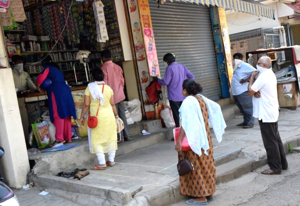 people queue up to purchase groceries on Day 2 of the 21-day nationwide lockdown imposed by the Narendra Modi government over the coronavirus pandemic; in Bengaluru on March 26, 2020. - Narendra Modi