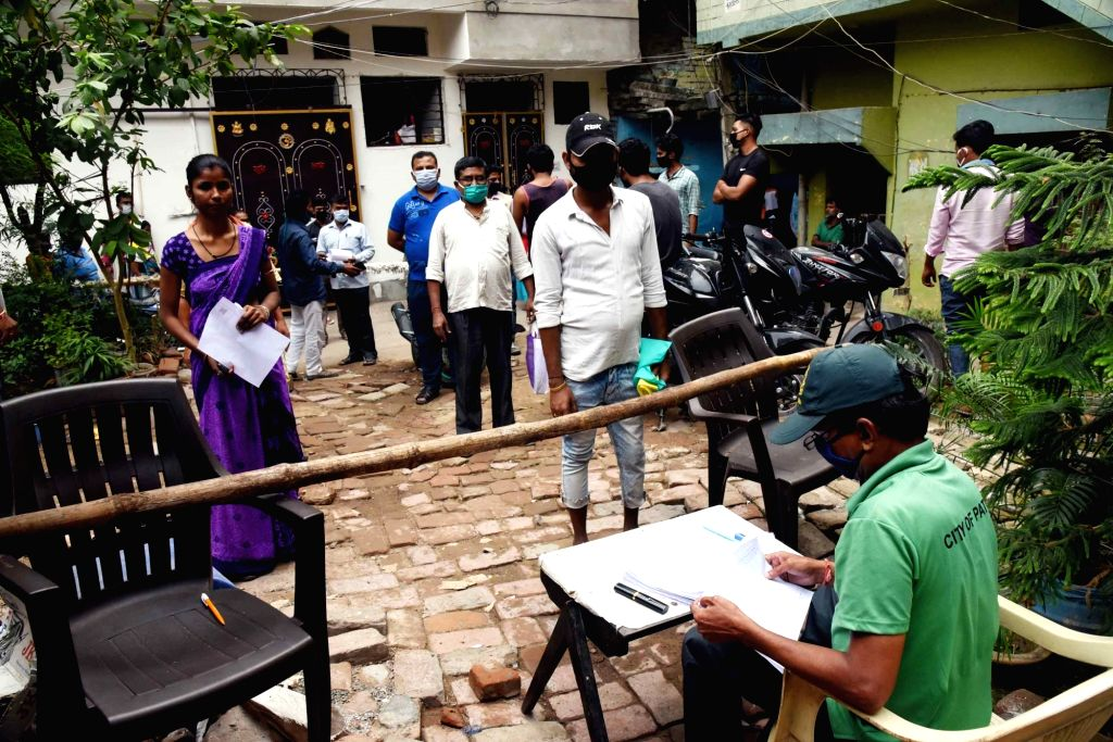 People queue up to submit forms for the application of new ration cards in Patna during the extended nationwide lockdown imposed to mitigate the spread of coronavirus; on Apr 24, 2020.