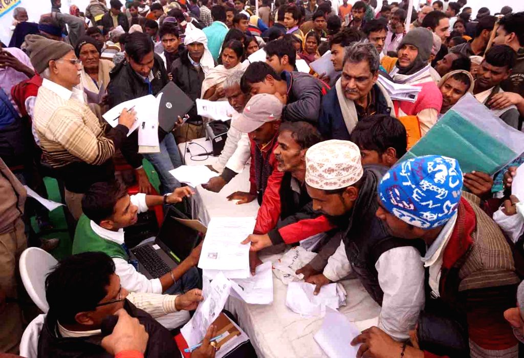 People registered their forms at a camp to get Tricycles which will be distributed to physically challenged people by Prime Minister Narendra Modi in Varanasi, on Jan 16, 2016. - Narendra Modi
