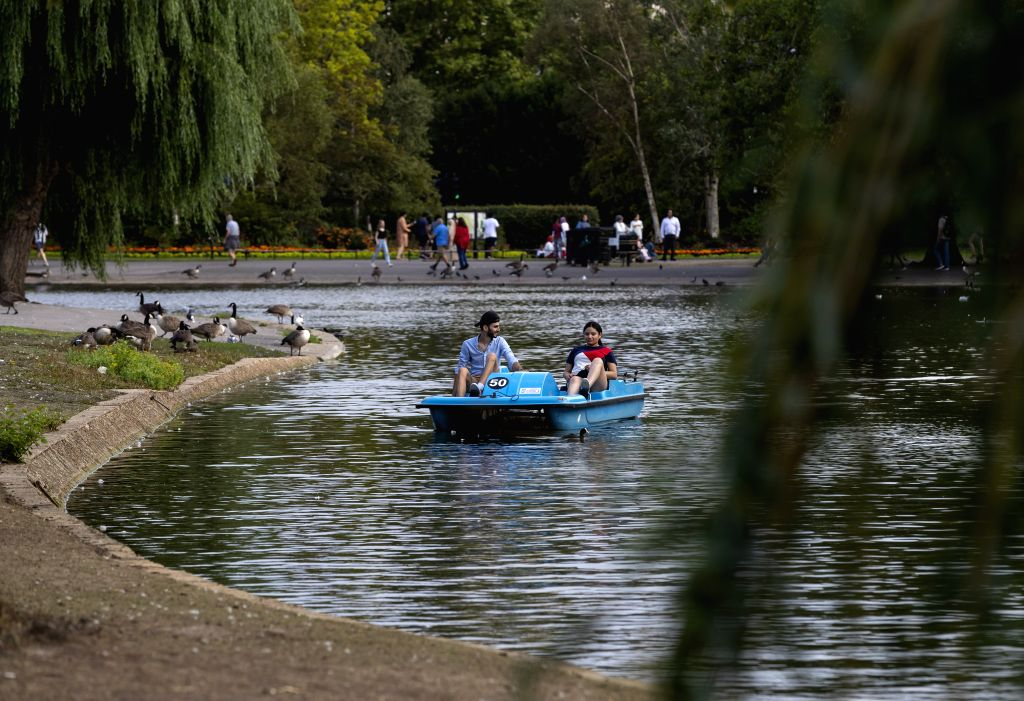 People relax on a pedal boat at Regent's Park in London, Britain on July 31, 2020.