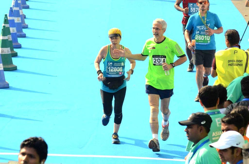 People run during the Standard Chartered Mumbai Marathon 2016 in Mumbai on Jan. 17, 2016