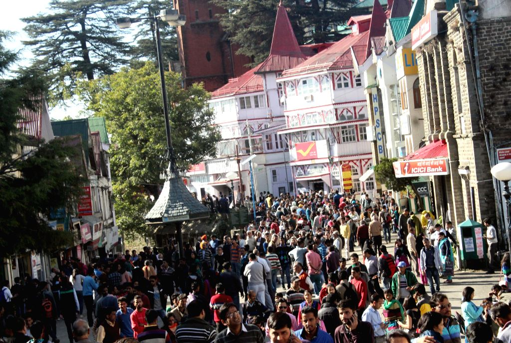 People rush out of buildings after an earth quake jolted Shimla on Oct 26, 2015.