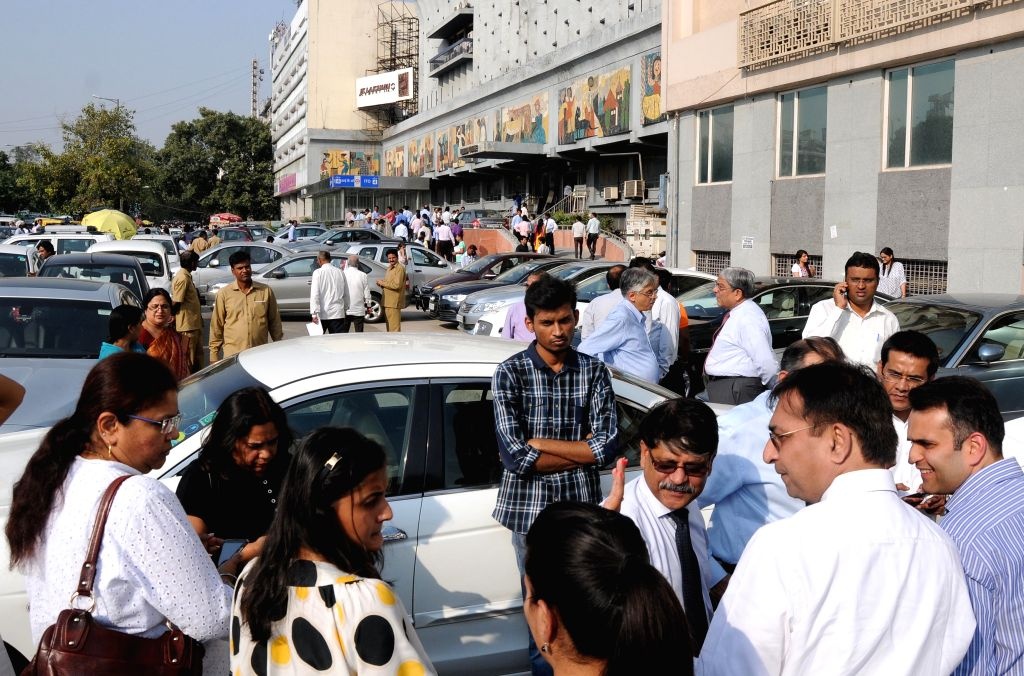 People rush out of offices as an earthquake jolted the Indian capital and its neighbouring region on Oct 26, 2015.