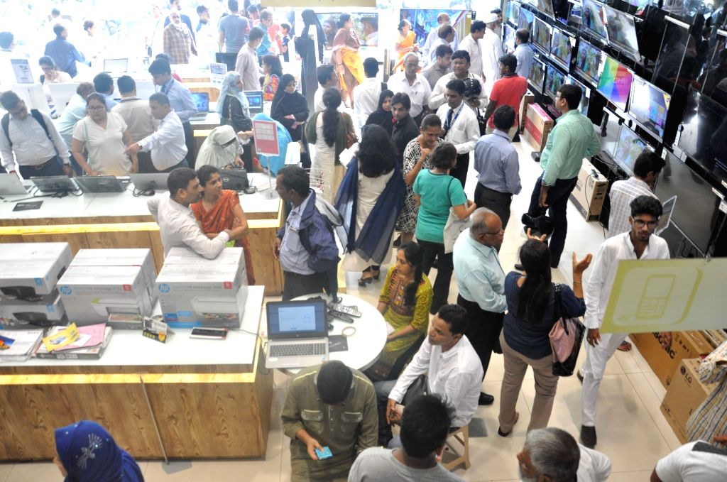 People rush to buy electronic items at a Mumbai showroom ahead of GST implementation on June 30, 2017.