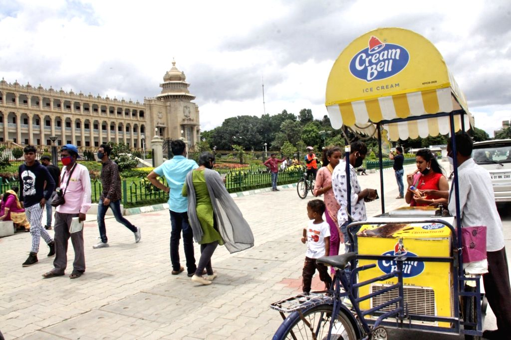 People seen buying ice-creams in front of the Vidhana Soudha after the State Government removed Sunday lockdowns amid COVID-19 pandemic, in Bengaluru on Aug 2, 2020.