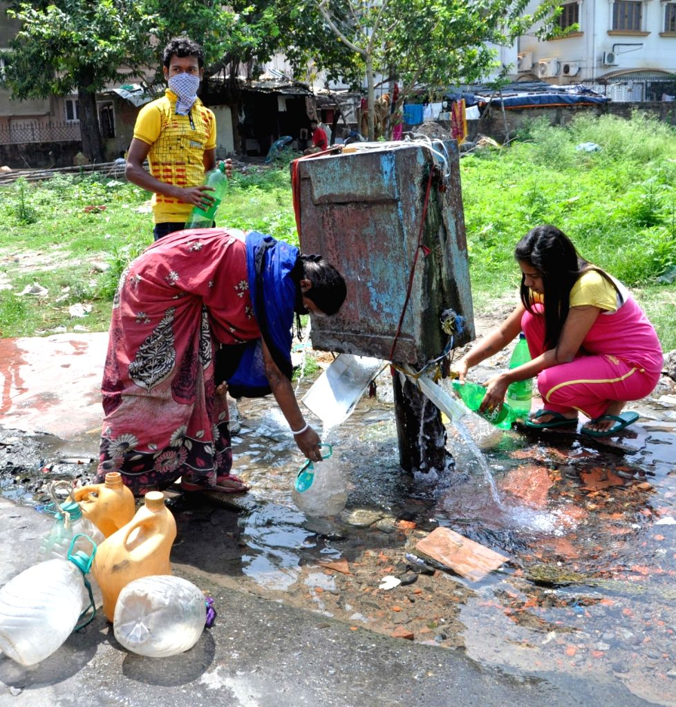 People seen collecting drinking water from a leaking municipal water supply line at Salt Lake on Day 2 of the 21-day nationwide lockdown imposed by the Narendra Modi government over the ... - Narendra Modi