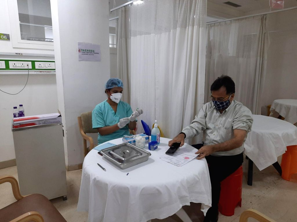 People seen excited during corona vaccination in private hospitals.