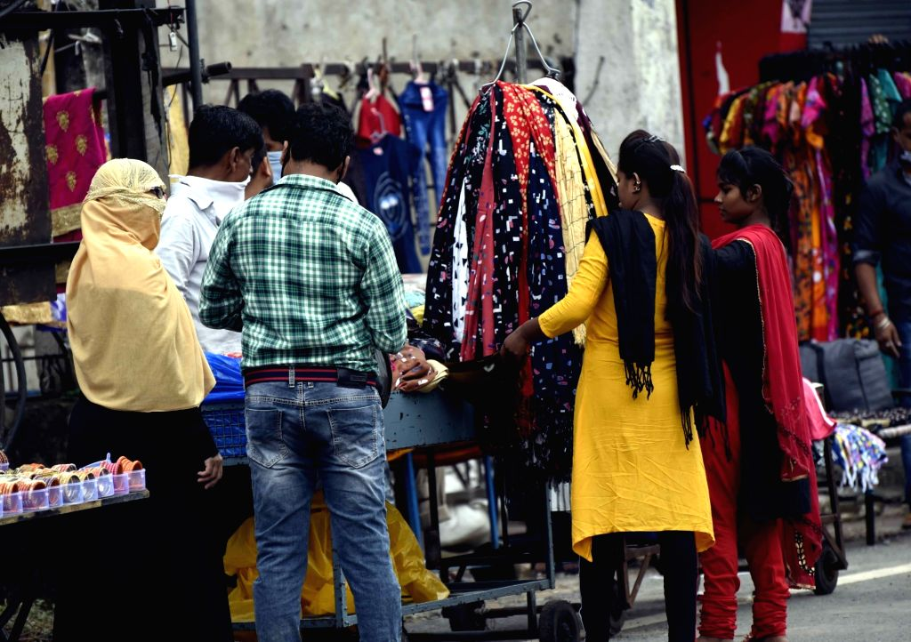 People seen shopping at Patna's Hathwa Market amid COVID-19 pandemic as festivals of Eid-Ul-Adha and Raksha Bandhan are approaching, on July 30, 2020.