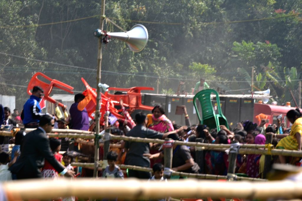 People seen throwing chairs during Prime Minister and BJP leader Narendra Modi's public meeting in Thakurnagar of North 24 Parganas district, West Bengal, on Feb 2, 2019. - Narendra Modi