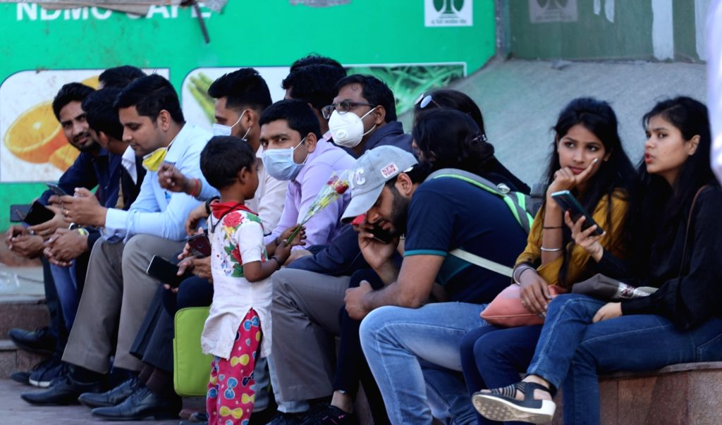 People seen wearing masks at Delhi's Connaught Place amid COVID-19 (coronavirus) pandemic, on March 18, 2020.