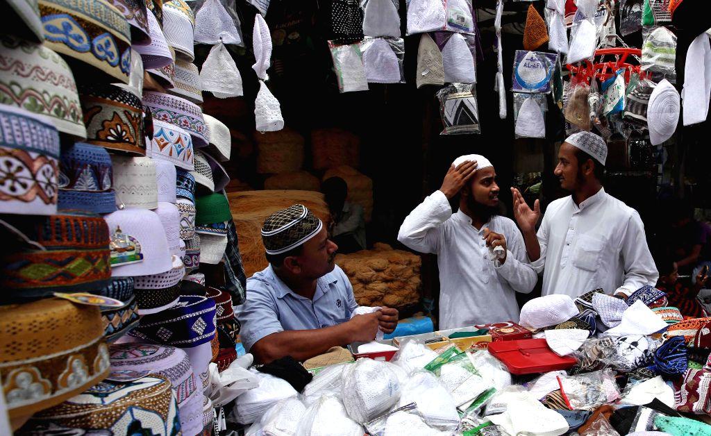 People sell prayer caps ahead of Eid ul-Fitr outside Nakhoda Masjid in Kolkata on July 28, 2014.
