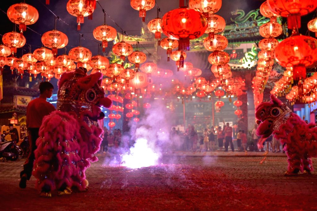 People set off firecrackers to greet the Chinese Lunar New Year in Cheras of Kuala Lumpur, Malaysia, Jan. 24, 2020.
