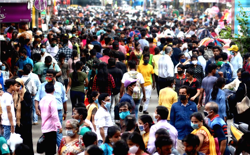People shopping at New market area on eve of Durga Puja festival in Kolkata on October 18, 2020.