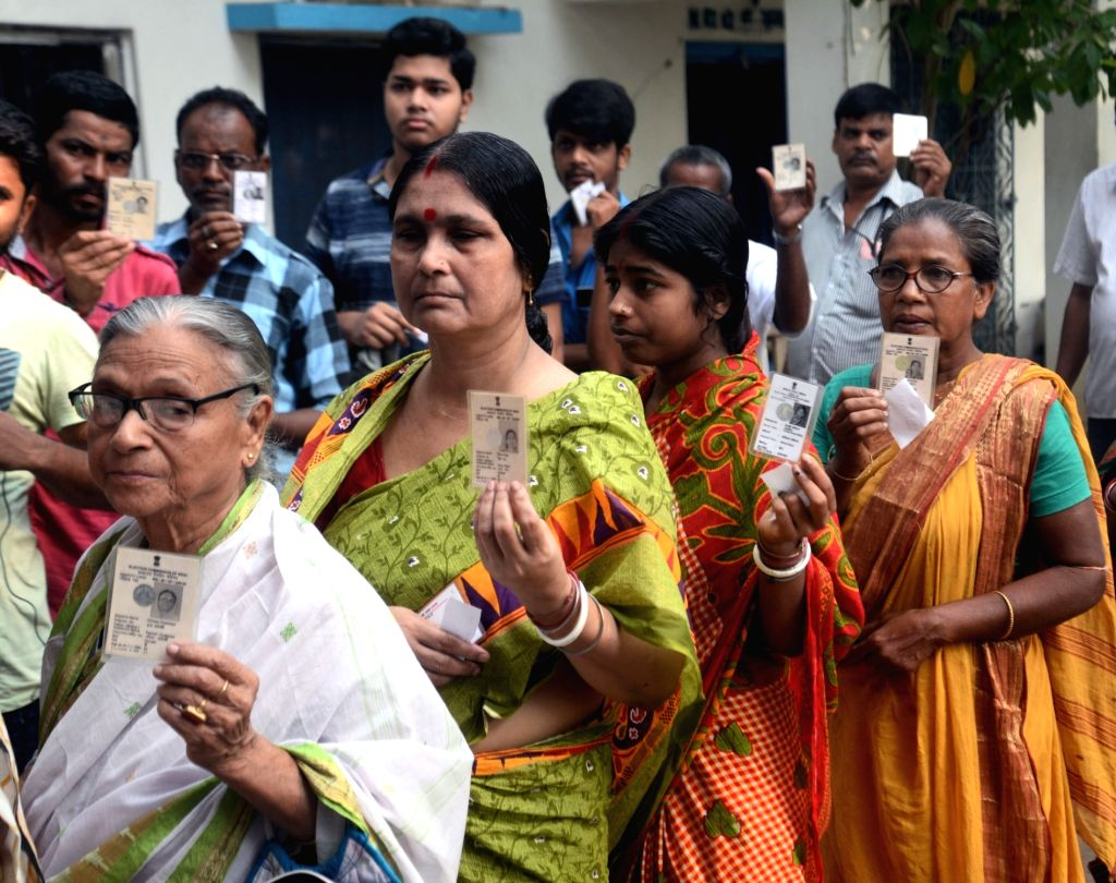 People show their voters ID card during the sixth phase of 2019 Lok Sabha polls, in West Bengal's Midnapore, on May 12, 2019.