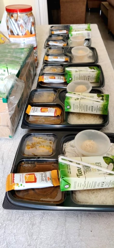 People showing food to the needy, out of hospitals to PPET