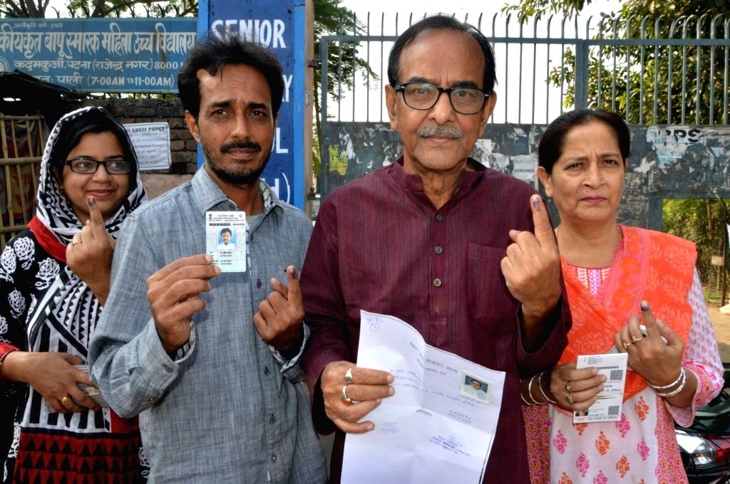 People showing their finger marked with phosphorous ink after casting their vote during the third phase of Bihar assembly polls in Patna on Oct 28, 2015.