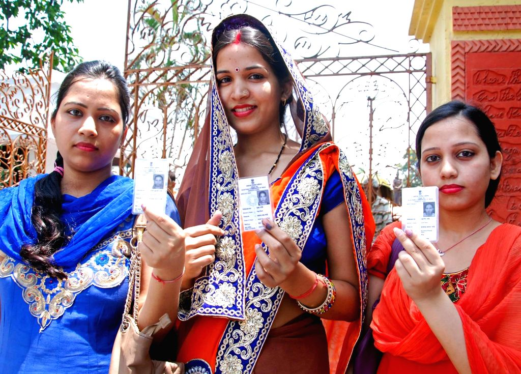 People shows their forefingers marked with phosphorus ink after casting her vote at the polling station during the West Bengal Assembly Election in Kolkata on April 21, 2016.