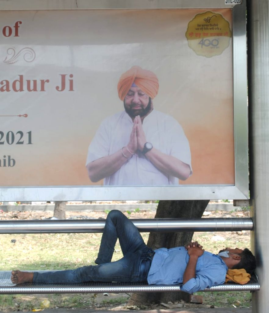 People sleeping in Dtc bus stand 2nd day during weekdays lockdown covid-19 in New Delhi on Sunday on Sunday, 18th April,2021.
