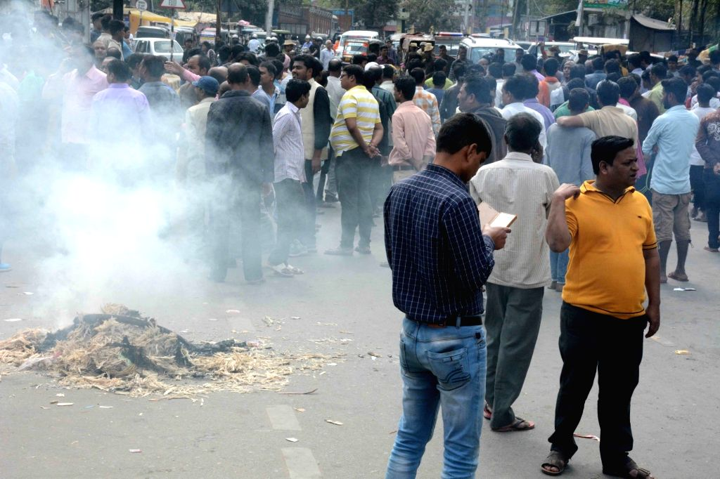 People stage a demonstration after a cake shop owner Purushotttam Kumar who was shot dead by unidentified bike-borne armed criminals after he tried to resist attempt to loot a bag filled with ... - Purushotttam Kumar