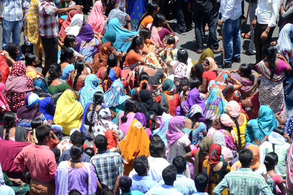 People stage a demonstration against amendment in  Employees Provident Funds and Miscellaneous Provisions Act, 1952 in Bengaluru, on April 18, 2016.
