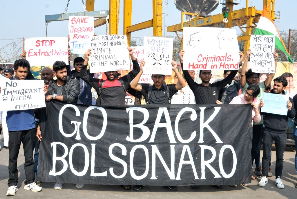 People stage a demonstration against Brazilian President Jair Bolsonaro during his four day visit to India, in Kolkata on Jan 26, 2020.