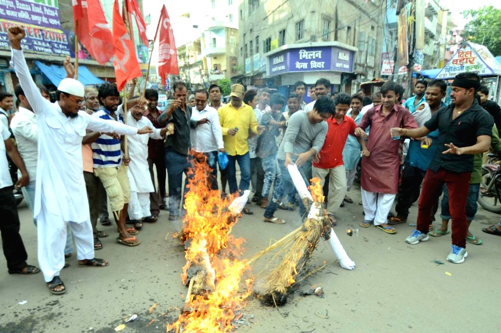 People stage a demonstration against hike in railway fares through surge pricing in Patna, on Sept 9, 2016.