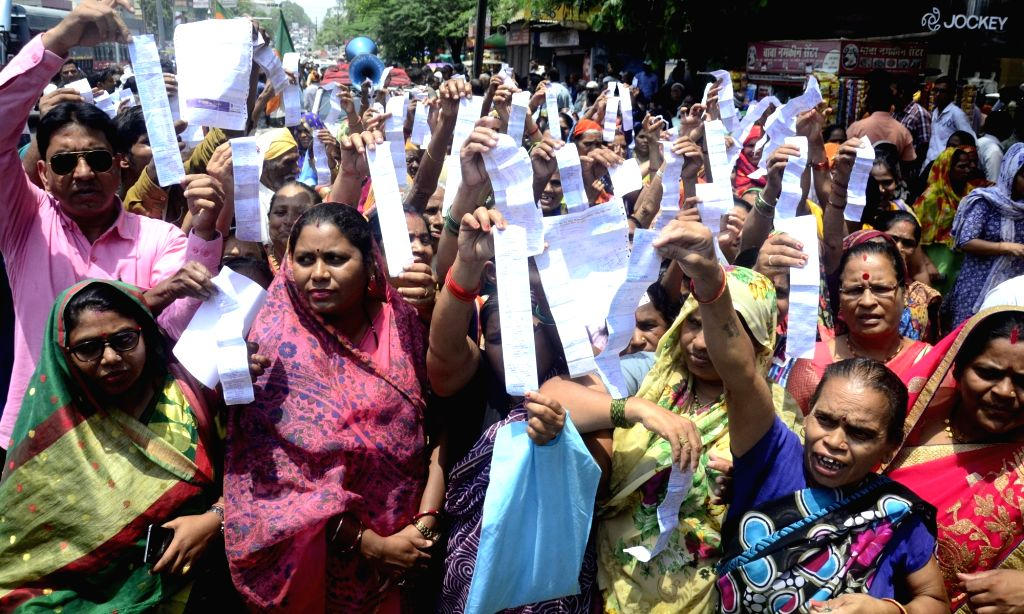 People stage a demonstration against hike in power tariffs in Bhopal on July 18, 2019.