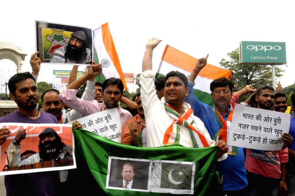 People stage a demonstration against Hizbul Mujahideen leader Syed Salahuddin in Patna on July 4, 2017.
