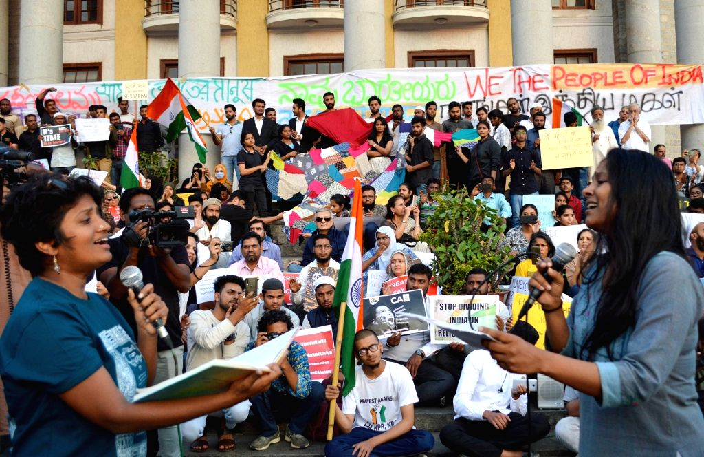 People stage a demonstration against the Citizenship Amendment Act (CAA) 2019, National Register of Citizens (NRC) and National Population Register (NPR) at Town Hall in Bengaluru on Jan ...