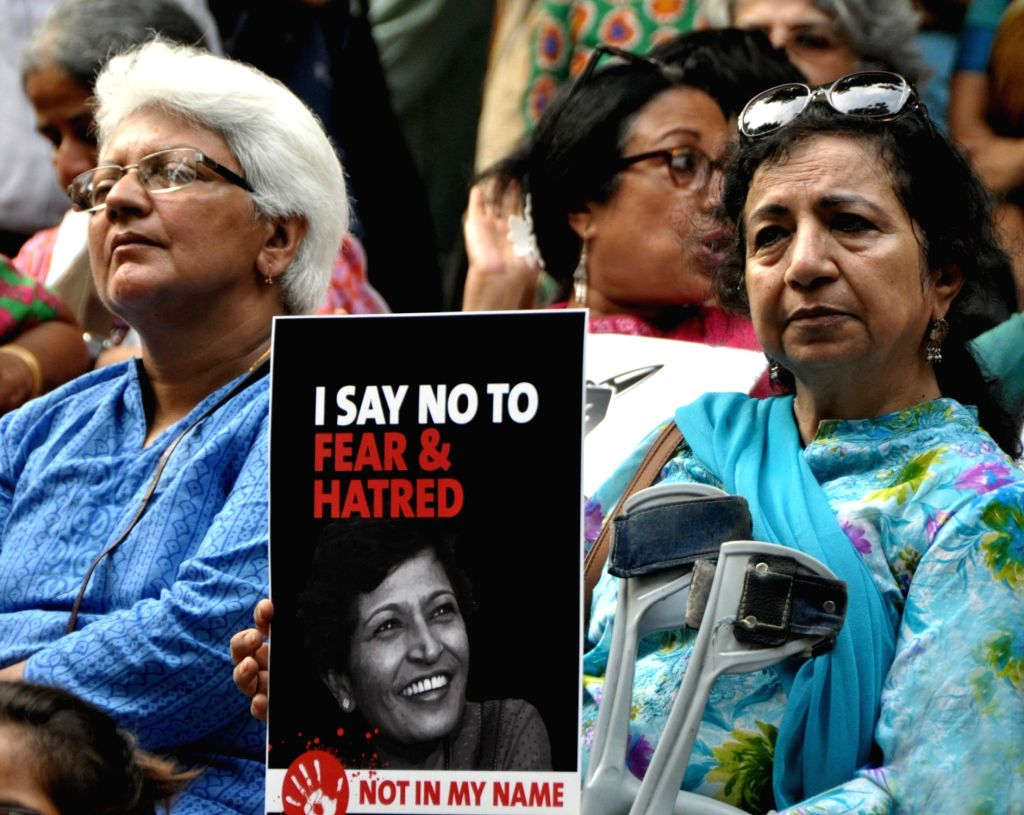"""People stage a demonstration- """"Not In My Name"""" to protest the killing of journalist turned activist Gauri Lankesh at Jantar Mantar in New Delhi on Sept 7, 2017. Lankesh who was ..."""