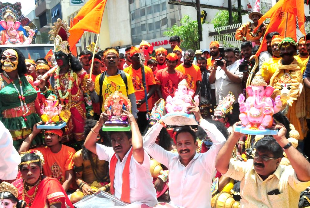 People stage a demonstration outside Karnataka State Pollution Control Board (KSPCB) office against BBMP's measure to curb usage of Plaster of Paris (PoP) in Ganesha idols in Bengaluru on ...