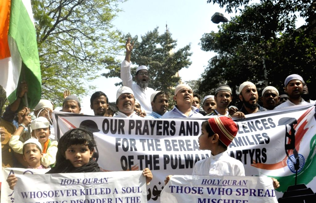 People stage a demonstration to condemn 14 Feb Pulwama militant attack, in Kolkata on Feb 22, 2019.