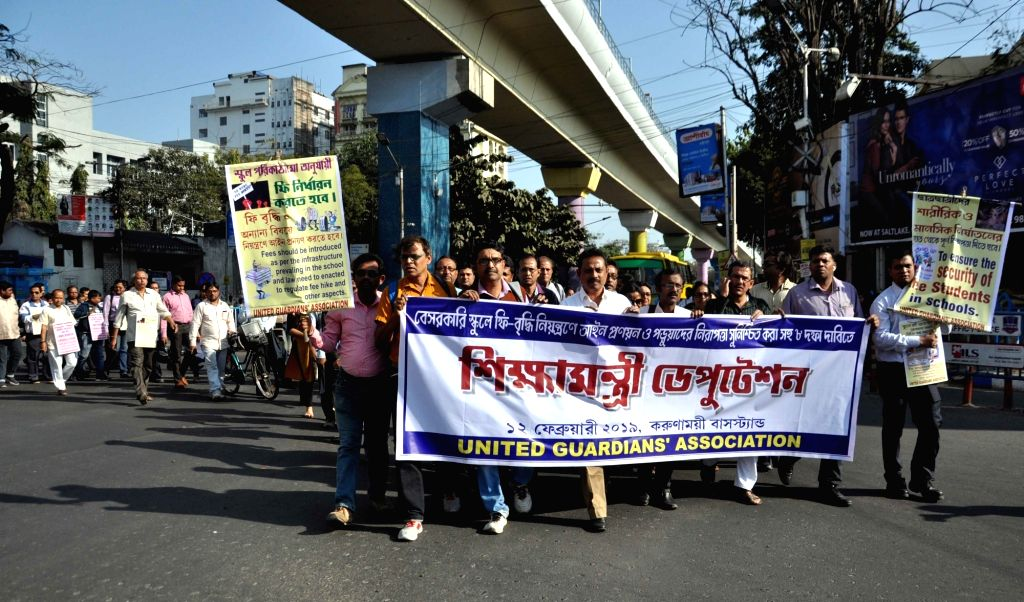 People stage a demonstration to protest against hike in school fees in Kolkata, on  Feb 12, 2019.