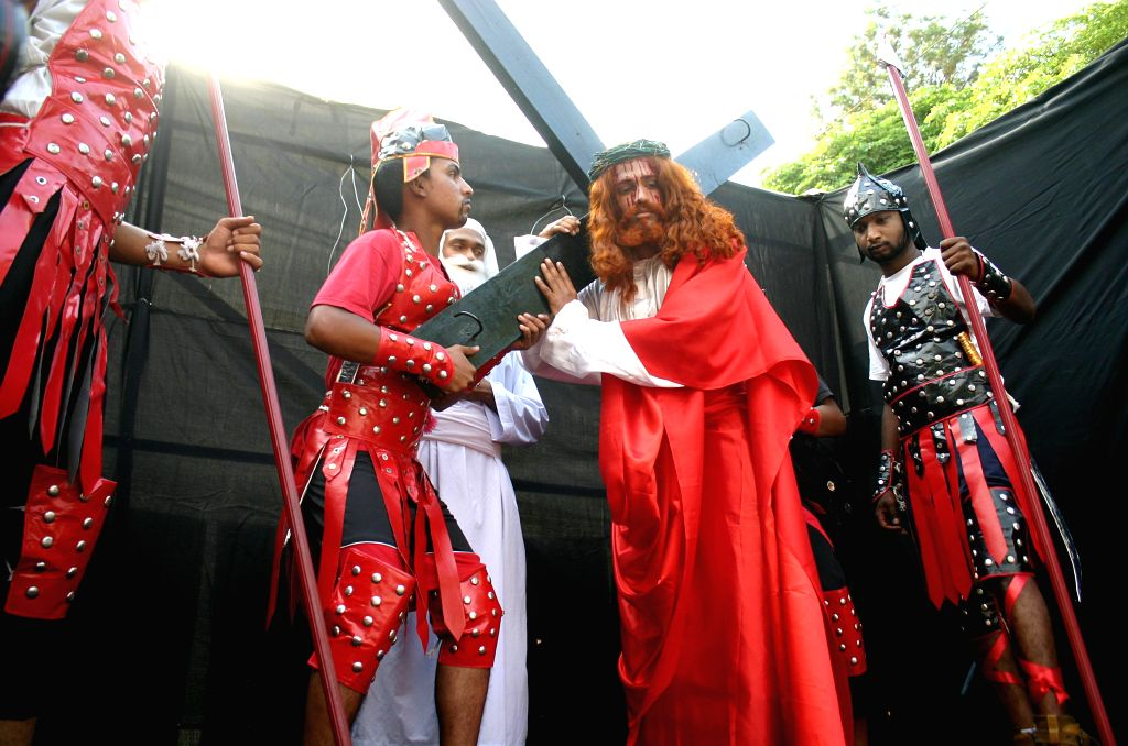 People stage a play on Good Friday in Bhopal on April 18, 2014.