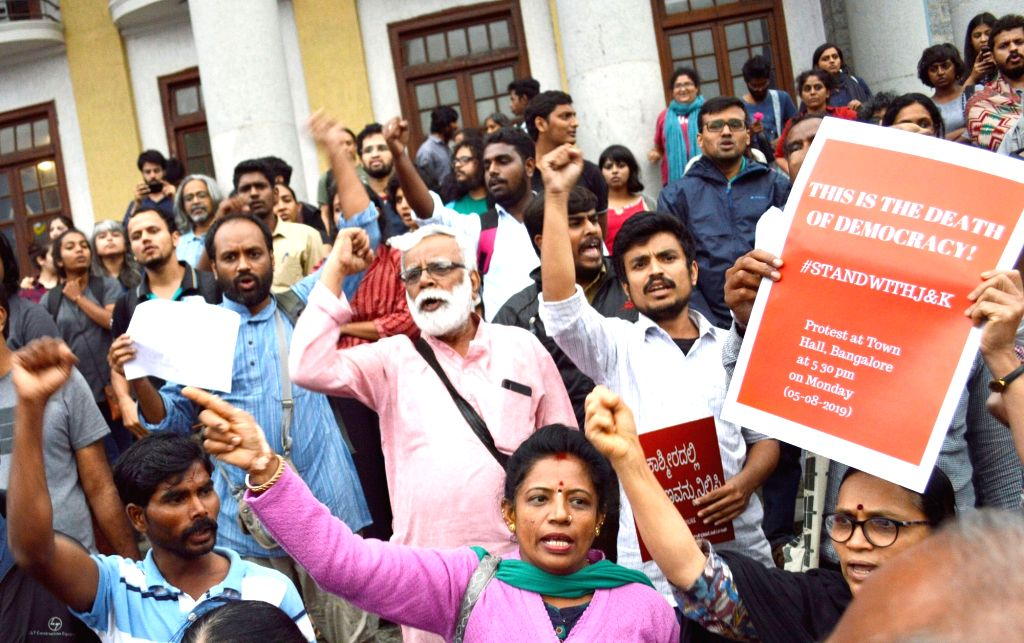 People stage a protest after Rajya Sabha passed the Jammu and Kashmir Reorganisation Bill 2019 and adopted the resolution to abrogate the Constitution's Article 370 in Bengaluru on Aug 5, ...