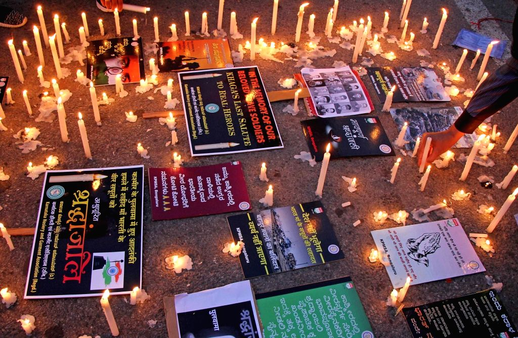 People stage a protest against suicide attack on a CRPF bus in Jammu and Kashmir's Pulwama district in which 45 soldiers lost their lives; in Bengaluru on Feb 15, 2019.